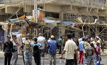 18 dead and dozens hurt in Baghdad bomb attacks