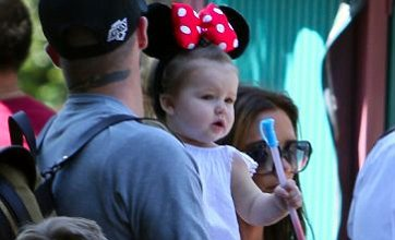 Harper Beckham dons Minnie Mouse ears for family day out at Disneyland