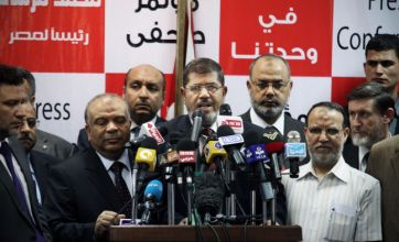 Egypt: Muslim Brotherhood claims poll victory for Mohammed Morsi