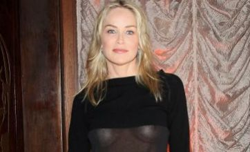 Sharon Stone does a Madonna as she proudly flashes her boobs in sheer top