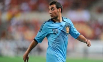Arsenal plot £15m move for Malaga winger Santi Cazorla