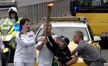 Boys try to grab Olympic torch from NHS staff as a prank in Coventry