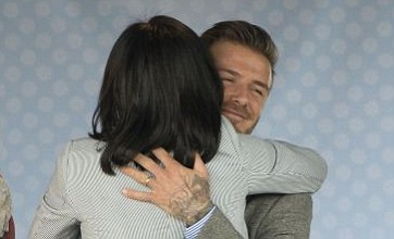 David Beckham gets up close and personal with very important fan
