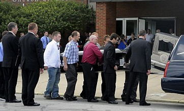 Hundreds pay last respects to murdered Batman fans
