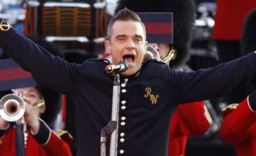 Robbie Williams close to finishing solo album and enlists fans' help for tour