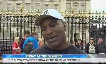 Evander Holyfield goes unnoticed during NBC Olympic interview