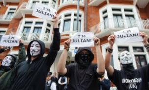 Protesters have gathered outside Ecuador's London embassy in support of Julian Assange, who is hiding out there (Image: PA)