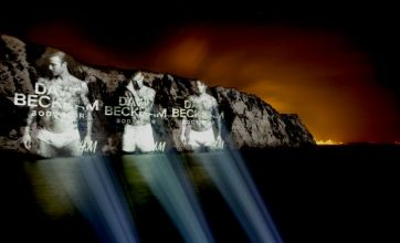 David Beckham projected onto White Cliffs of Dover in just his underwear