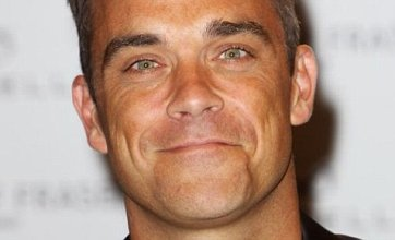 Robbie Williams 'knocked for six' following Gary Barlow's tragic loss