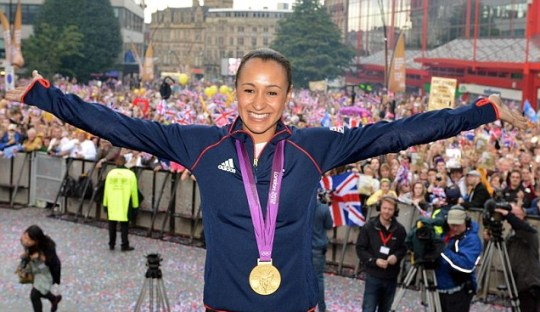 Jessica Ennis celebrating with her gold medal during her Olympic homecoming in Sheffield city centre