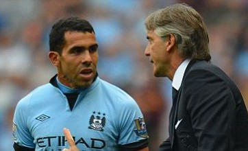 Happy Carlos Tevez gives champions Manchester City reason to smile