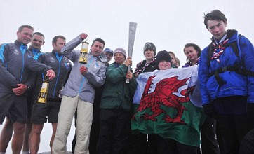 Paralympic flame sparked as dawn climbers ascend peaks across Britain