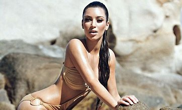 Kim Kardashian continues to dig out super sexy semi-naked swimwear pics