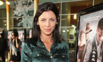 Liberty Ross shows Rupert Sanders what he's missing on red carpet