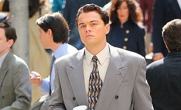 Leonardo DiCaprio gets suited up on set of Wolf Of Wall Street