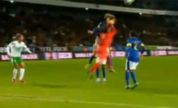 David Luiz takes a punch from his own goalkeeper in Brazil's win over Iraq