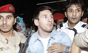 Lionel Messi stares down the barrel of a rifle during trip to Saudi Arabia