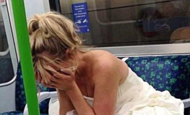 Got the Blues: Bridge Hannah Booth pictured on the Tube on her wedding day (Picture: Twitter)