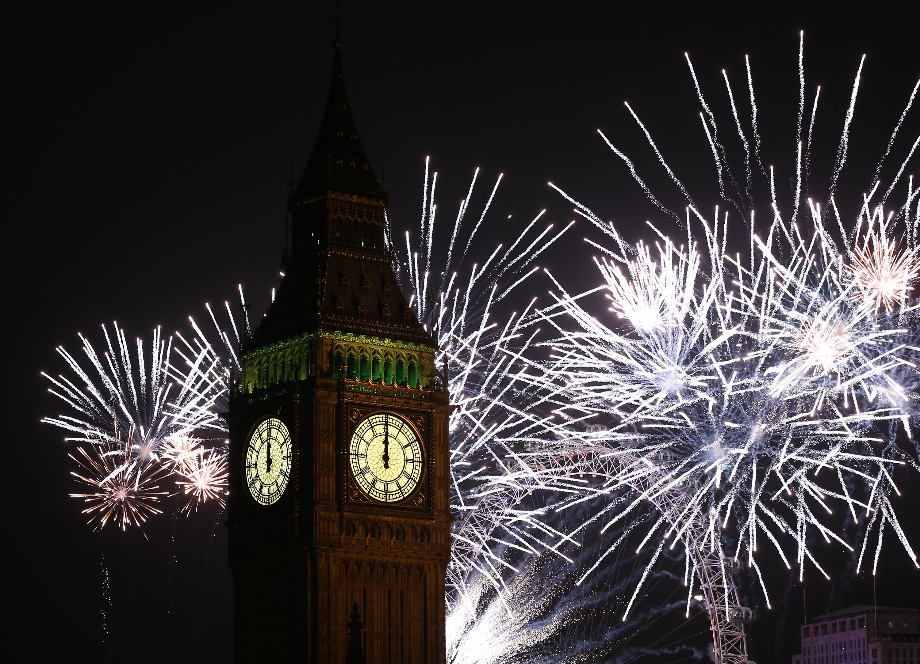 Fireworks light up the London skyline and Big Ben just after midnight. (Picture: Getty)