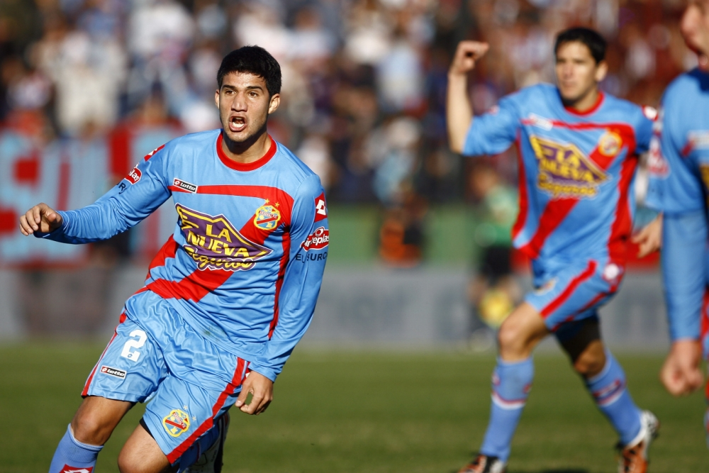 Wanted: Arsenal's Lisandro Lopez is wanted by both Arsenal and Milan (Picture: Getty)