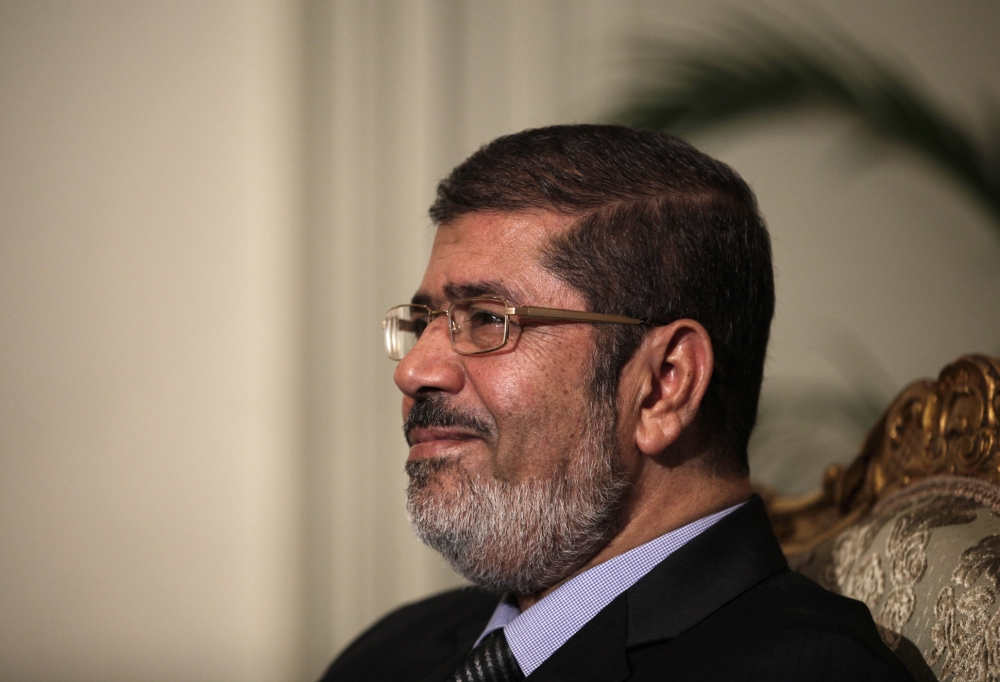Egypt: Mohamed Morsi backs down on decree but faces constitution clashes