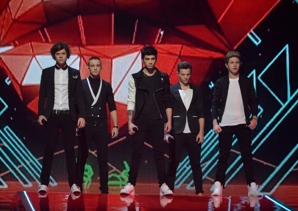 One Direction's performance on The X Factor was hit by a technical glitch (Picture: Rex)