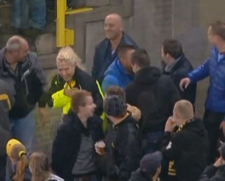 Vitesse fan takes a tumble while kicking ball back from upper tier of football stand
