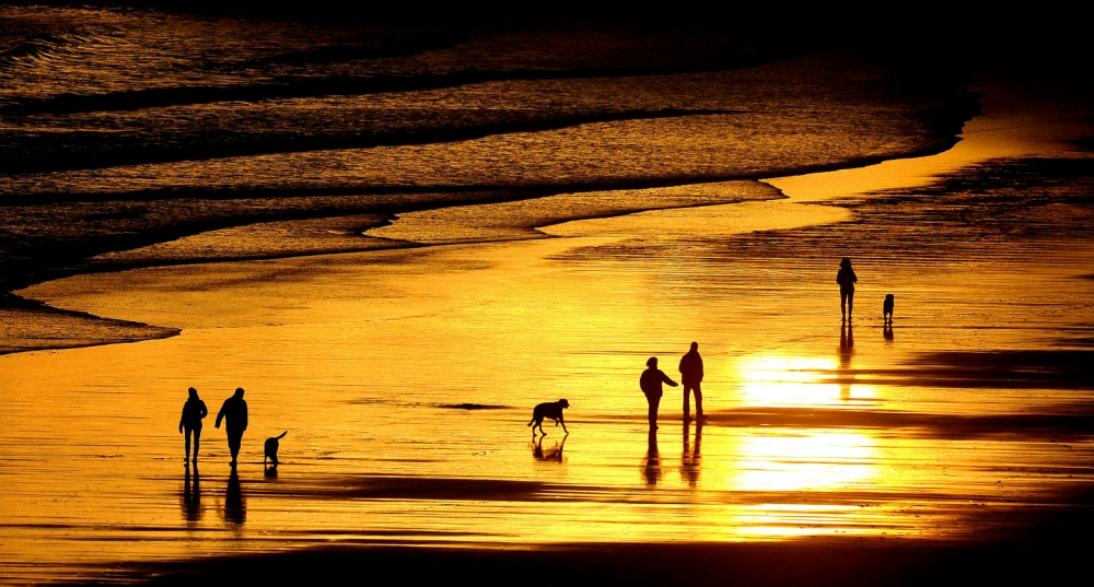 Sun reflects on the sand as it rises in Tynemouth