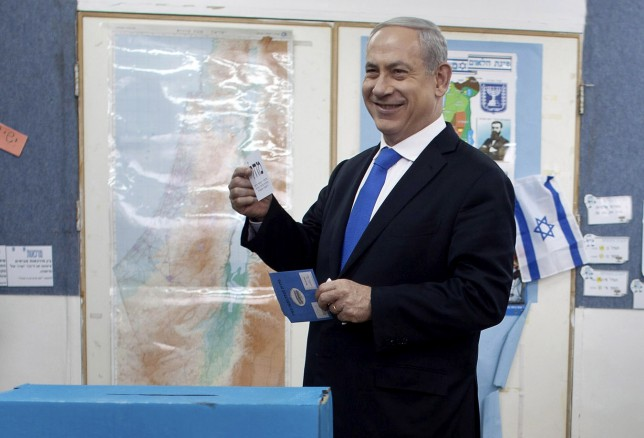Israeli Prime Minister Benjamin Netanyahu casts his ballot at a polling station in Jerusalem