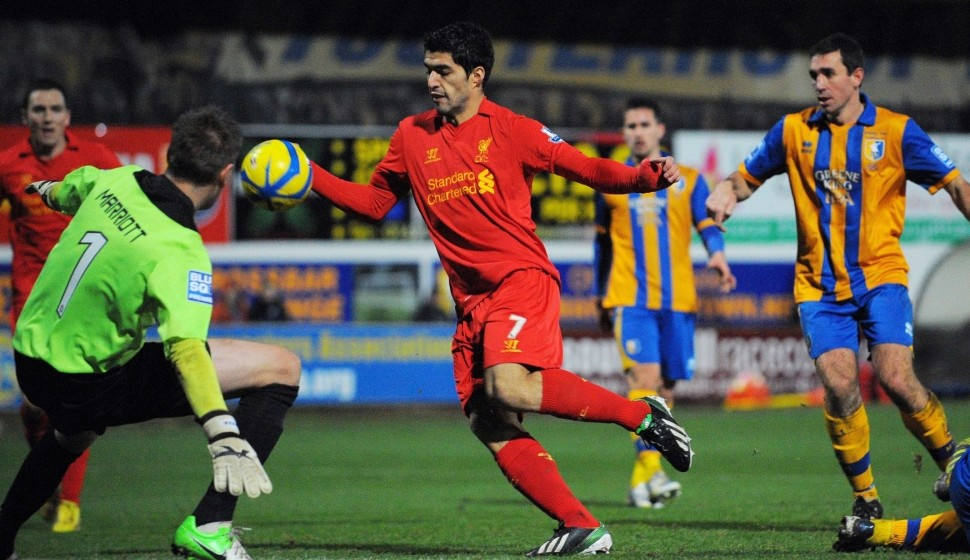 Luis Suarez handles the ball against Mansfield