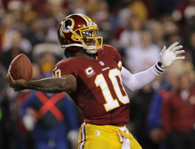 Washington Redskins quarterback Robert Griffin III (10) passes against the Seattle Seahawks during their NFL NFC wildcard playoff game in Landover, Maryland, January 6, 2013. REUTERS/Laurence Kesterson (UNITED STATES - Tags: SPORT FOOTBALL)