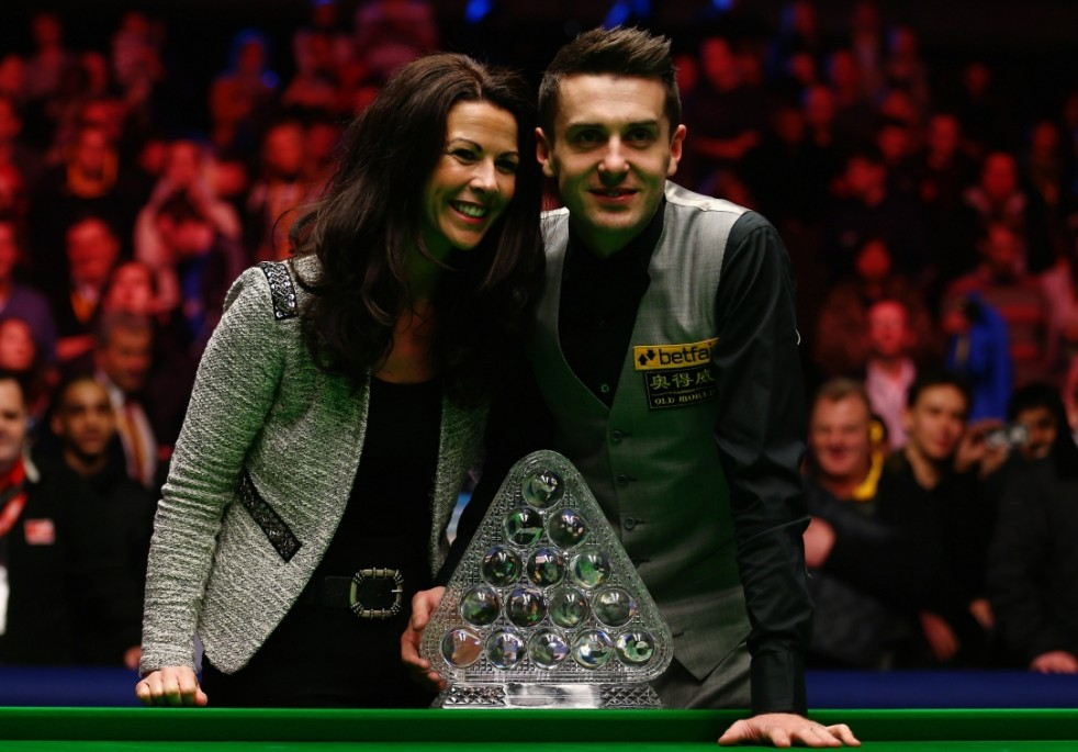 Mark Selby of England celebrates with his wife Vikki Layton
