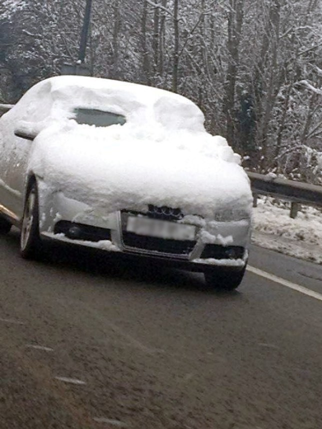 Audi on M4 with snow on windscreen