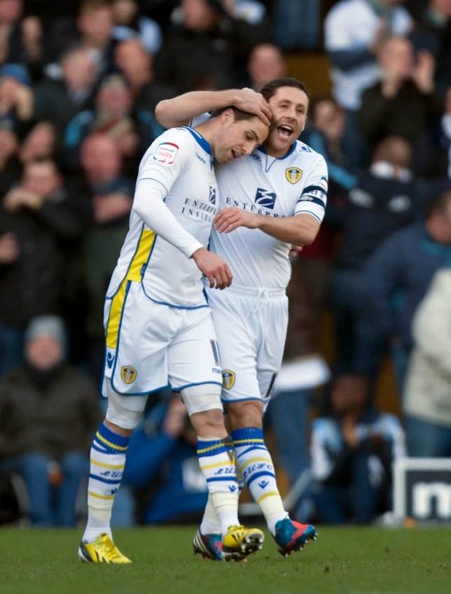 Luke Varney (left) hit the opening goal in Leeds' 2-1 win over Spurs (Picture: AP)