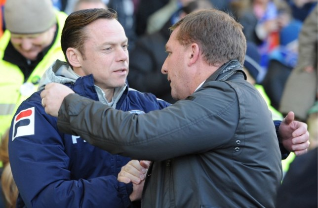 Paul Dickov (left) still fears for his job despite an incredible victory over Liverpool (Picture: Reuters/Action Images)