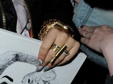 Rita Ora steps on Rihanna's toes in bullet ring