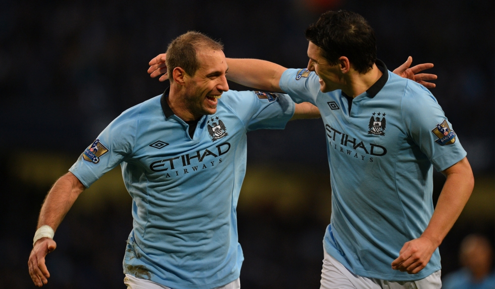 Pablo Zabaleta (left) opened the scoring just before half-time (Picture: AFP)