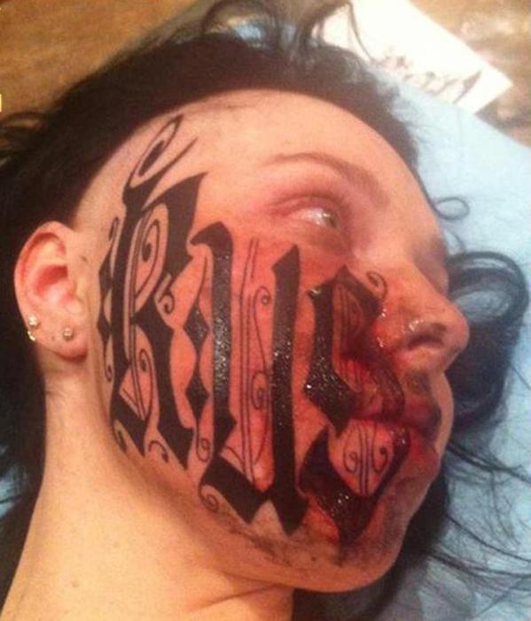 Lesya Toumaniantz , face tattoo