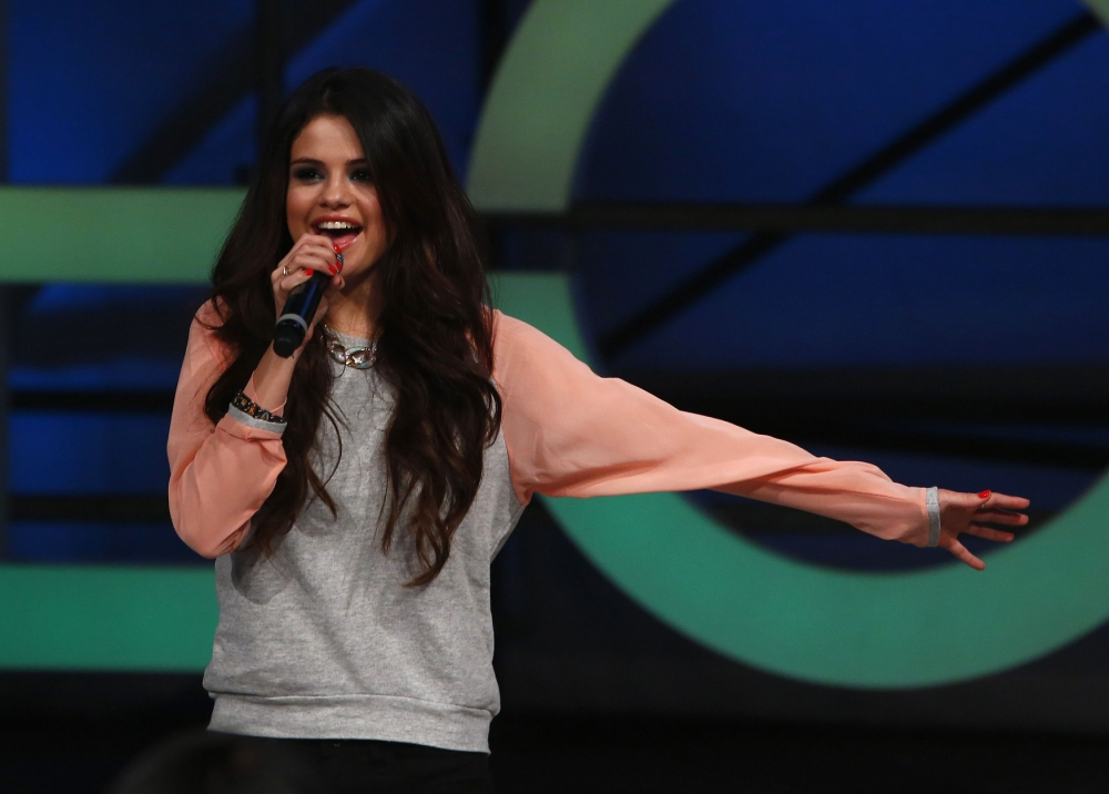 Thank you for the music: Selena Gomez has revealed she plans to hang up her microphone in favor of movie making (Photo: REUTERS/Eric Thayer)