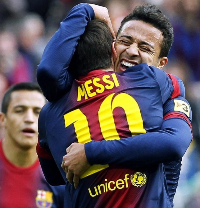 Happy days: Messi is hugged by Alexis Sanchez after netting against Getafe (Picture: EPA)