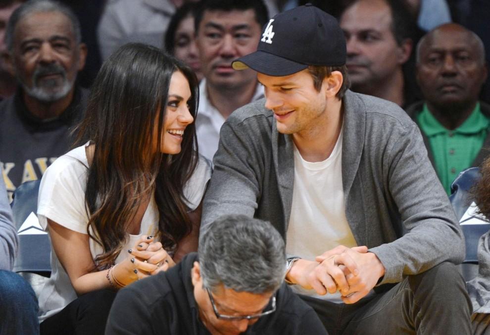 Mila Kunis cuddles up to Ashton Kutcher as she reveals Valentine's Day demands