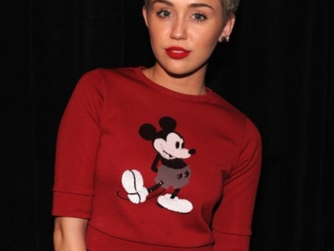 Miley Cyrus manages to keep her boobs covered up but flashes her midriff at Marc Jacobs NYFW show
