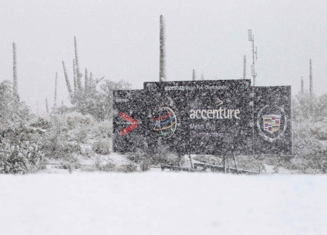A tournament scoreboard is covered in snow