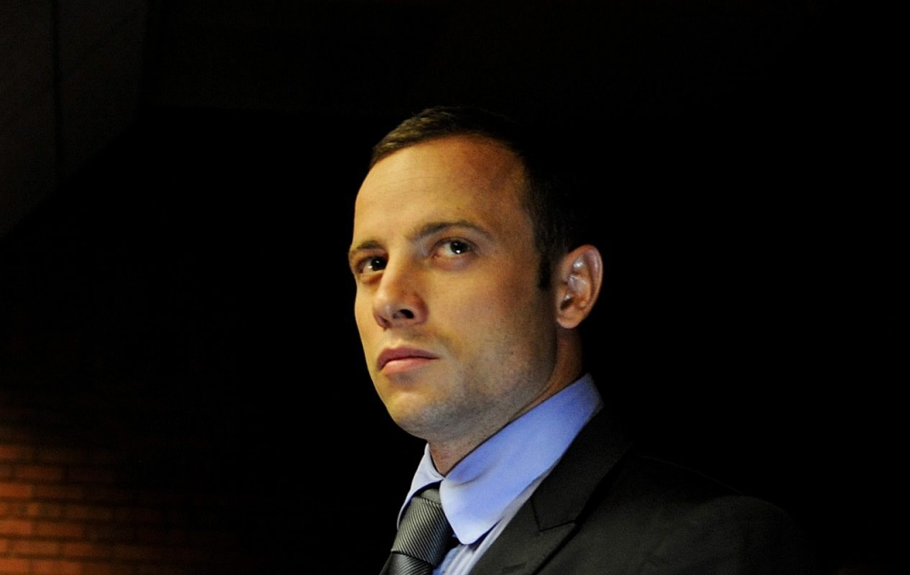Oscar Pistorius family at war after father accused of racism over gun comments
