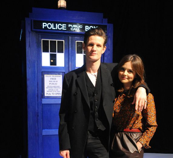 Matt Smith and Jenna-Louise Coleman stand in front of the TARDIS (Picture: PA)