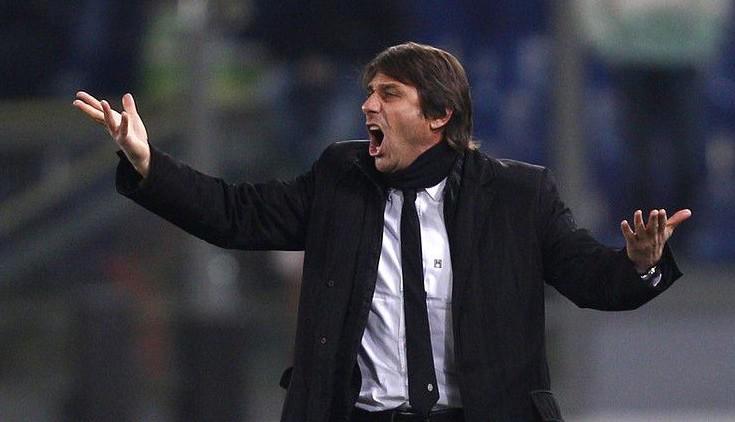 Antonio Conte says his side must remain professional despite taking a 3-0 lead into tomorrow's second leg (Picture: AP)