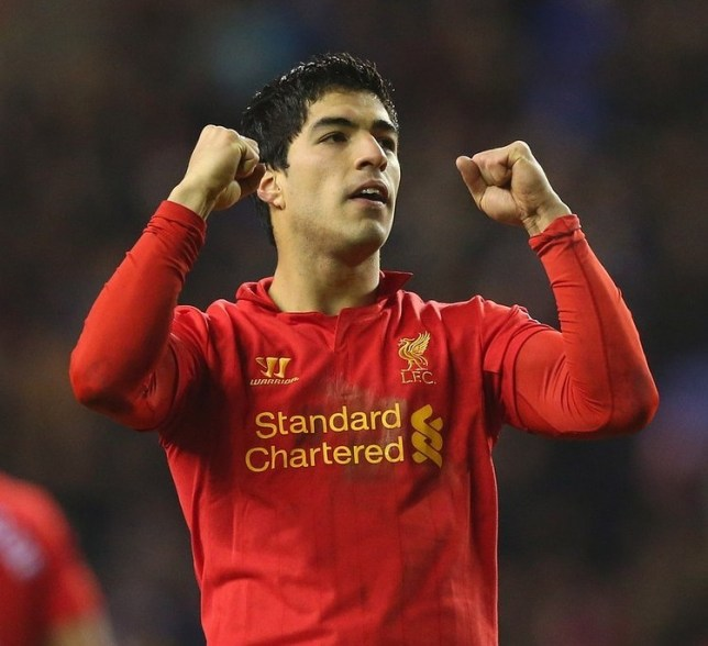 WIGAN, ENGLAND - MARCH 02:  Luis Suarez of Liverpool celebrates after scoring his third goal to complete a hat trick during the Barclays Premier League match between Wigan Athletic and Liverpool at the DW Stadium on March 2, 2013 in Wigan, England. Getty Images