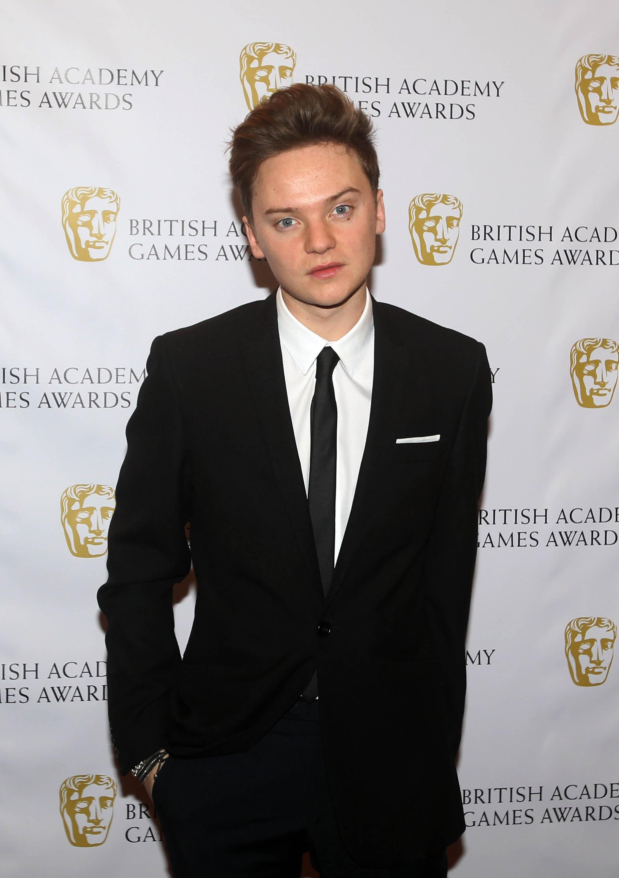Conor Maynard planning to hide behind Justin Timberlake's drum kit so he can finally meet the star at Yahoo! Wireless Festival