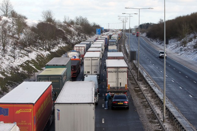 Going snow-where: Lorries queued for miles on M20 (Picture: PA)
