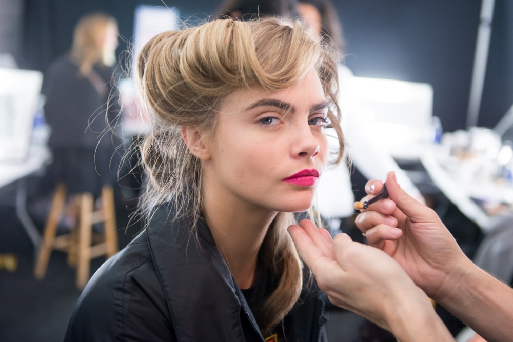 NEW YORK, NY - FEBRUARY 10:  Model Cara Delevingne prepares backstage at Diane Von Furstenberg during Fall 2013 Mercedes-Benz Fashion Week at The Theatre at Lincoln Center on February 10, 2013 in New York City.  (Photo by Michael Stewart/WireImage)